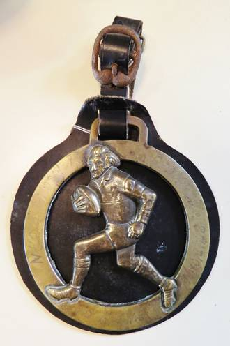 Antique Rugby Horse Brass on Leather