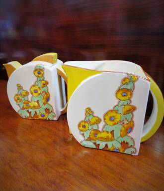 Clarice Cliff Bizarre A/F Pottery teapot & Milk Jug with Sunshine pattern $1200