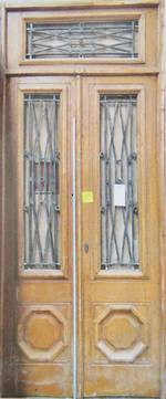 Pair of Doors with White Iron Grilles $3500 pair