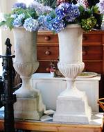 Pair of Large Concete Urns on Plinths