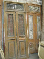 Pair of Wooden Doors With Iron Grilles
